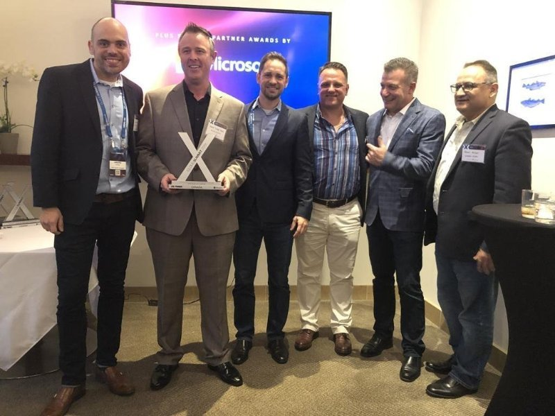 Craig Slack in the 2nd to the left holding the Microsoft Azure Partner of the Year Award for Invero.