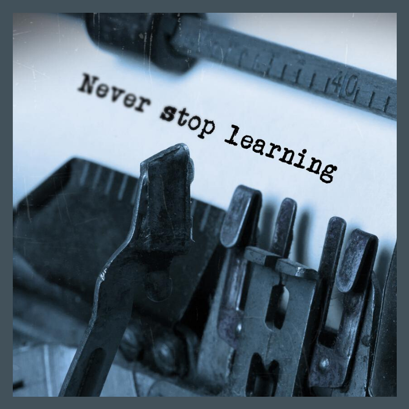 Never stop learning typed on paper with typewrite referring to cloud learning.