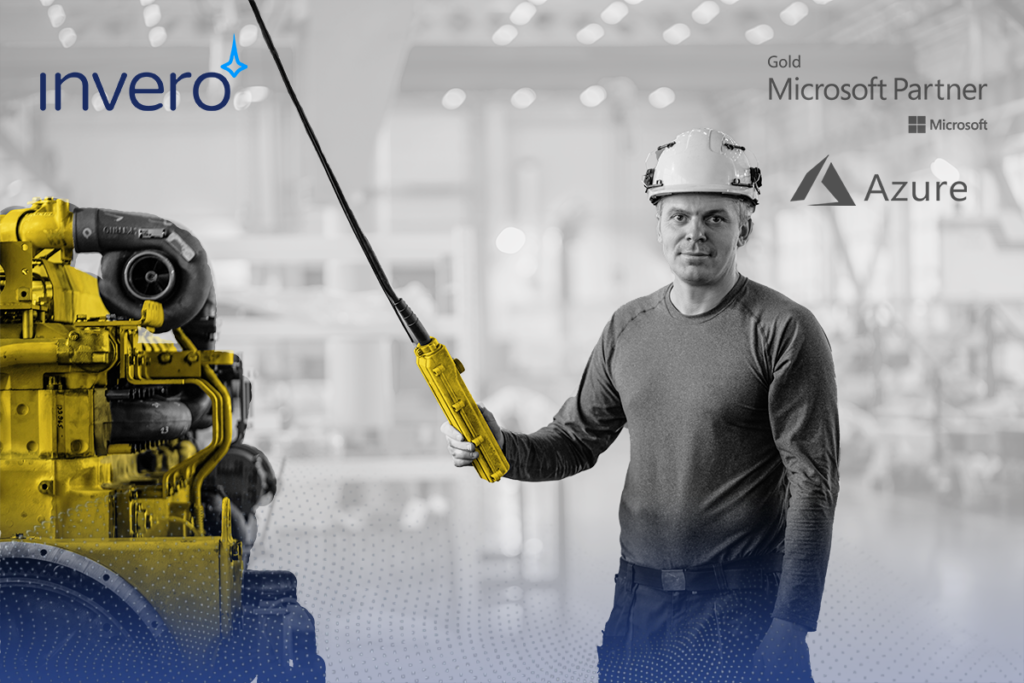 Man with hard hat holding a remote for a machine for the manufacturing industry