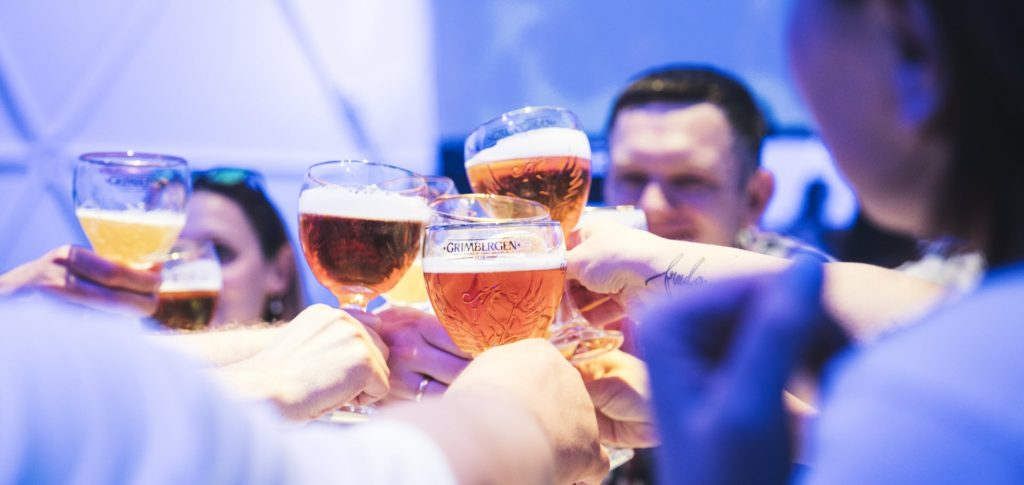 Carlsberg clinks beer glasses together to cheer
